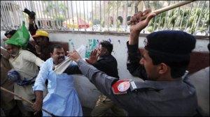 Pakistani Police beating people